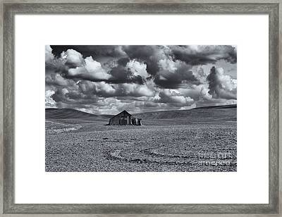 Lonely Barn On The Prairie Framed Print by Mike Dawson