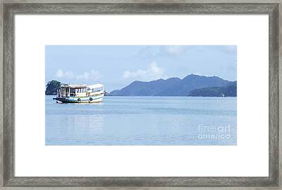 Lonely Boat Framed Print by Andrea Anderegg