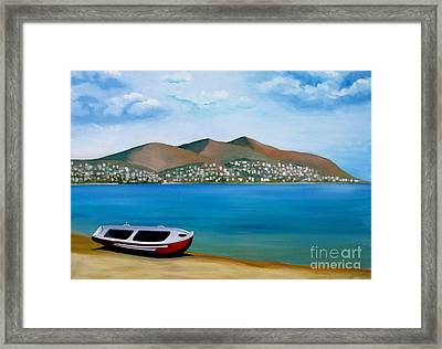 Lonely Boat Framed Print by Kostas Koutsoukanidis