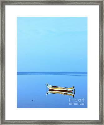 Framed Print featuring the photograph Lonely Boat by Mohamed Elkhamisy