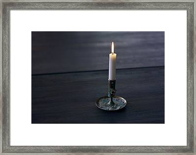 Lonely Candle Framed Print