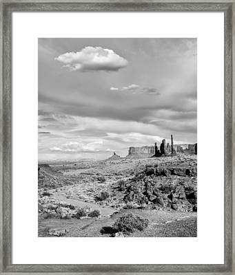Lonely Cloud And Totem Pole - Monument Valley Tribal Park Arizona Framed Print by Silvio Ligutti