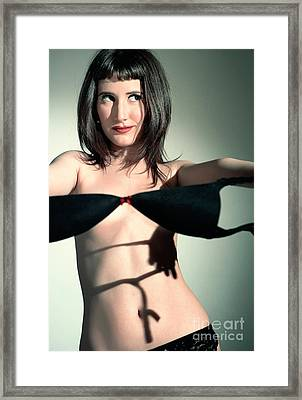 Long Dark Haired Woman In Lingerie Taking Off Black Bra Framed Print