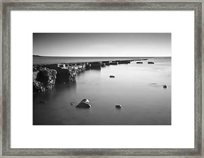 Long Exposure Image Of Tide Going Out Over Rock Ledge During Sun Framed Print by Matthew Gibson