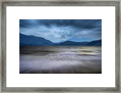 Long Exposure Landscape Of Stormy Sky And Mountains  Over Lake Framed Print