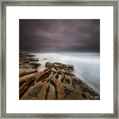 Long Exposure Sunset On A Dark Stormy Framed Print by Larry Marshall