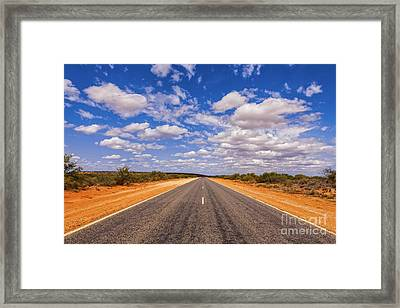 Long Straight Road Australia Outback Framed Print by Colin and Linda McKie