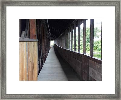 Long Walkway In Covered Bridge Framed Print by Catherine Gagne