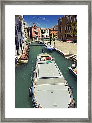Longboat In Venice Framed Print by Rick Starbuck
