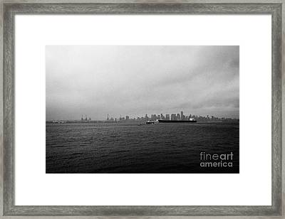 looking across Vancouver harbour to vancouver downtown skyline on dull grey rainy day BC Canada Framed Print by Joe Fox