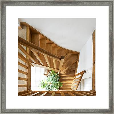 Looking Down A Wooden Staircase Framed Print by Corepics