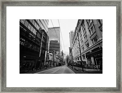 looking down granville street shopping area between the bay and pacific centre Vancouver BC Canada Framed Print by Joe Fox