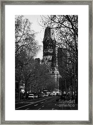 looking down Kurfurstendamm towards Kaiser Wilhelm Gedachtniskirche memorial church Berlin Germany Framed Print