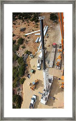 Looking Down On Dissembling A Crane... Framed Print by Chris Martin