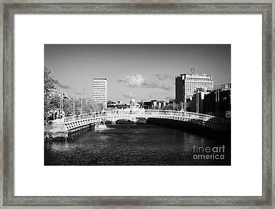 Looking Down The Liffey Towards The Hapenny Ha Penny Bridge Over The River Liffey In Dublin Framed Print by Joe Fox