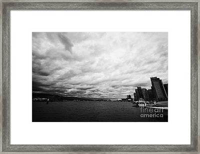 looking out from coal harbour into Vancouver Harbour on an overcast cloudy day BC Canada Framed Print by Joe Fox