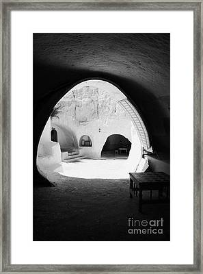 looking out from one of the caves at the Sidi Driss Hotel underground at Matmata Tunisia scene of Star Wars films vertical Framed Print