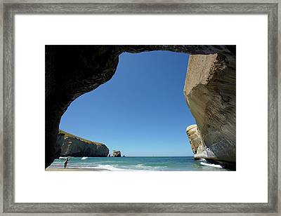 Looking Out From Sea Cave, Tunnel Framed Print by David Wall