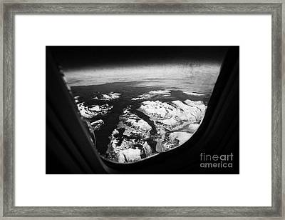 Looking Out Of Aircraft Window Over Snow Covered Fjords And Coastline Of Norway  Framed Print by Joe Fox