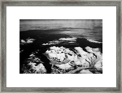 Looking Out Of Aircraft Window Over Snow Covered Fjords And Coastline Of Norway Northern Europe Framed Print by Joe Fox