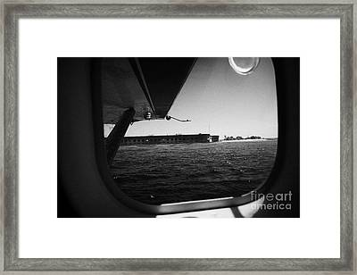 Looking Out Of Seaplane Window Coming In To Land On The Water In A Seaplane Next To Fort Jefferson G Framed Print by Joe Fox