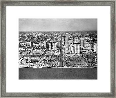 Looking Up Flagler Street At Downtown Miami Framed Print by Underwood Archives