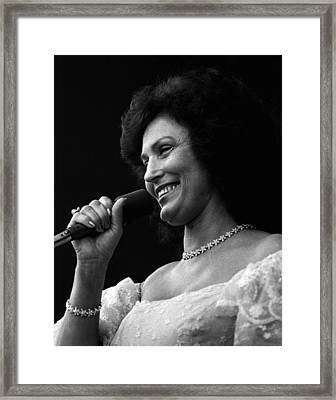 Loretta Lynn Singing  Framed Print by Retro Images Archive