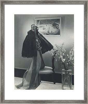 Loretta Young Wearing A Fur Cape Framed Print