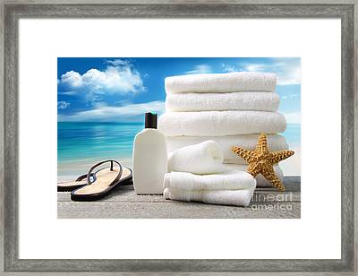 Lotion  Towels And Sandals With Ocean Scene Framed Print by Sandra Cunningham