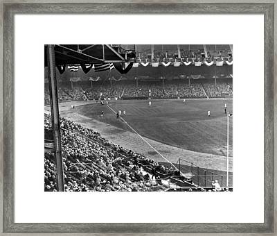 Lou Gehrig Playing First Framed Print by Underwood Archives