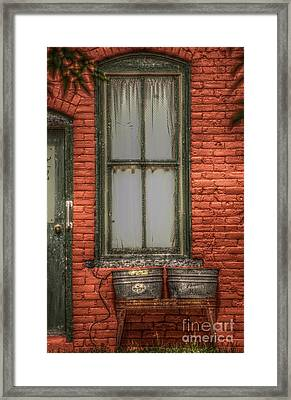 Louanns Launderette Framed Print by The Stone Age
