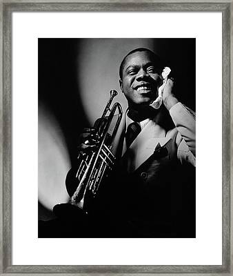 Louis Armstrong Holding A Trumpet Framed Print by Anton Bruehl