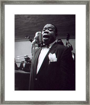 Louis Armstrong Sings Into The Mic. Framed Print by Retro Images Archive