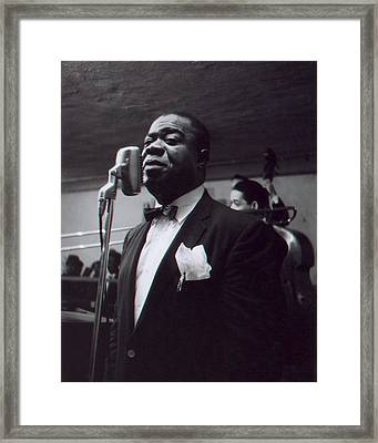 Louis Armstrong Stands In Front Of The Microphone Framed Print by Retro Images Archive