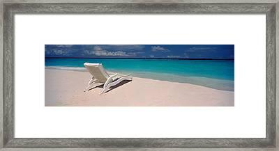 Lounge Chair On The Beach, Thulhagiri Framed Print