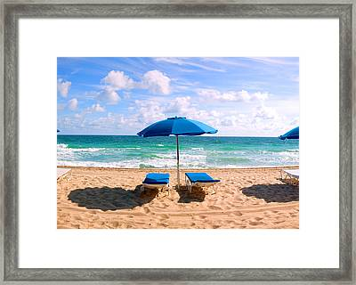 Lounge Chairs And Beach Umbrella Framed Print by Panoramic Images