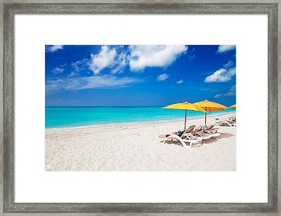 Lounge Chairs And Yellow Umbrellas Framed Print by Jo Ann Snover