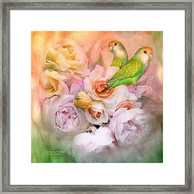 Love Among The Roses Framed Print by Carol Cavalaris