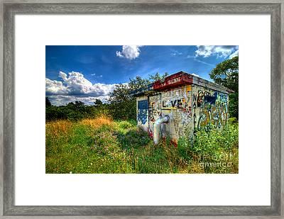Love Graffiti Covered Building In Field Framed Print