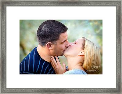 Love Kissing Couple Framed Print by Michal Bednarek