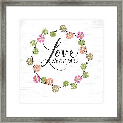 Love Never Fails Framed Print by Katie Doucette