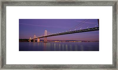 Low Angle View Of A Bridge At Dusk Framed Print by Panoramic Images