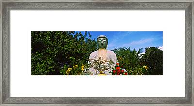 Low Angle View Of A Buddha Statue Framed Print
