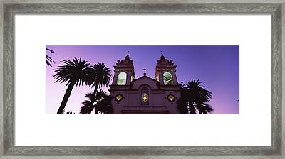 Low Angle View Of A Cathedral Lit Framed Print by Panoramic Images
