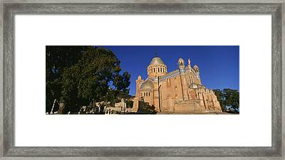 Low Angle View Of A Church, Notre Dame Framed Print by Panoramic Images