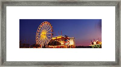 Low Angle View Of A Ferries Wheel Lit Framed Print by Panoramic Images