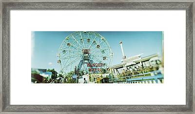 Low Angle View Of A Ferris Wheel Framed Print
