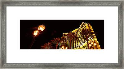 Low Angle View Of A Hotel Lit Framed Print