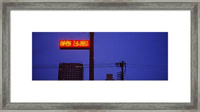 Low Angle View Of A Neon Sign, San Framed Print