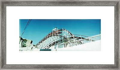 Low Angle View Of A Rollercoaster Framed Print